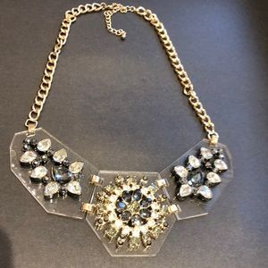 Brass/lucite necklace with grey crystal medallions